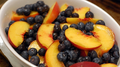 blueberries and peaches in a bowl